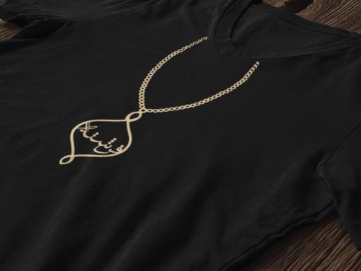 Golden pendent design on black t-shirt